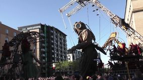 The giant Deep-Sea diver in Montreal, Quebec. May 19-21, 2017: The giant deep-sea diver walking toward the street of Montreal, Quebec, where he will meet his