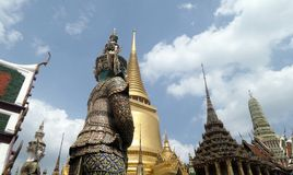 Giant demon guarding an entrance to Wat Phra Kaew Stock Images