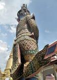 Giant demon guarding an entrance to Wat Phra Kaew Stock Photography