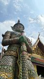 Giant demon guarding an entrance to Wat Phra Kaew Royalty Free Stock Photography