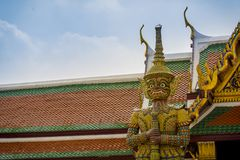 Giant demon guarding an exit in Wat Phra Kaew, Bangkok. Stock Images