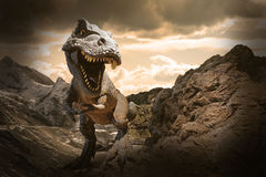 Giant Dinosaur. On dry rocky mountain background stock photos
