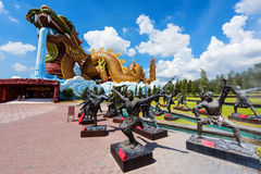 Giant Dragon monument and Chinese Kung fu statue Royalty Free Stock Photography