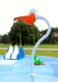 Giant Duck Head, Slide And A Frog A City Splash Park. Giant Duck Head, Slide and A Green Frog at a Splash Park,  under blue skies Royalty Free Stock Photography