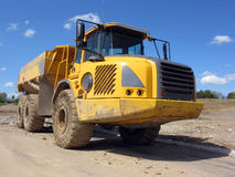Giant Dump Truck. Giant Yellow Dump Truck On A Construction Site Royalty Free Stock Image