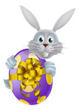 Giant Easter egg and white bunny Stock Images