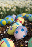 Giant Easter Eggs with petals on wood chips Royalty Free Stock Photos