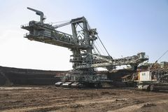 Giant excavator in a coal mine Stock Images