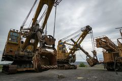 Giant excavators are on the brink of a great career. stock photos