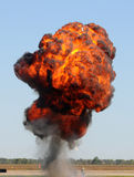 Giant explosion. Large outdoors explosion with fire and smoke Royalty Free Stock Photo