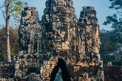 Giant face south gate bridge angkor thom cambodia Stock Image