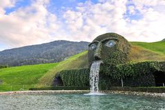 The Giant face and water feature, marking the entrance to Swarovski Crystal World Stock Photography