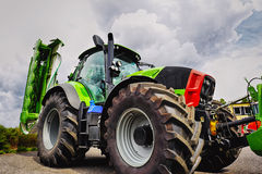 Giant farming tractor, tires and plough Stock Image