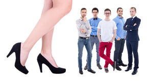 Giant female legs and little business men isolated on white Royalty Free Stock Images