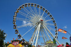 Giant Ferris Wheel. Opening day at the Orange County Fair, Costa Mesa, CA.  Between 12 noon and 1 p.m. admission and parking was free.  By 2:30 p.m. the Royalty Free Stock Images