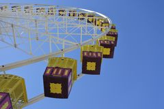 Giant Ferris Wheel against blue sky. Background. Low angle view royalty free stock photo