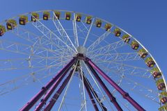 Giant Ferris Wheel against blue sky. Background. Low angle view royalty free stock images