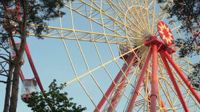Giant ferris wheel against blue sky and white cloud which mean an amusement-park stock video