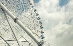 Giant ferris wheel in amusement against cloudscape royalty free stock images