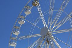 Giant ferris wheel with chairs, metallic structure, recreational element near the river stock image