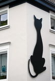 Giant figure of black cat on a white wall in Altena Stock Photography