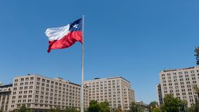 Giant flag on Avenida La Alameda with the citizenship Square. In downtown Santiago de Chile. Chile Royalty Free Stock Photos
