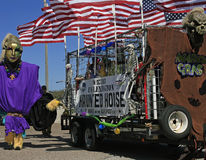Giant, Flags and Haunted House in the Barefoot Mardi Gras Parade Stock Photos