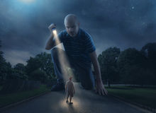 Giant with flashlight. A huge giant discovers a person walking on the road royalty free stock photography