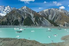 Giant floating icebergs on Tasman Glacier Lake in Aoraki Mount Cook National Park, South Island of New Zealand.  stock photo