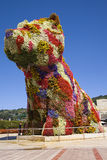 Giant floral dog Puppy, by Jeff Koons. Giant floral dog sculpture Puppy, by Jeff Koons, at the entrance of the Guggenheim Bilbao Museum, in Bilbao, Basque Stock Photography