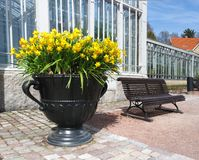 Giant flower pot and bench Stock Photo