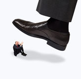 Giant foot about to step on a person Stock Photos