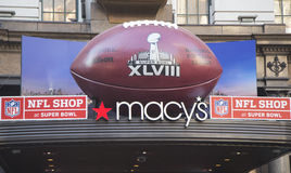 Giant Football at Macy s Herald Square on Broadway during Super Bowl XLVIII week in Manhattan. NEW YORK - JANUARY 30 Giant Football at Macy s Herald Square on stock photography