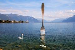 Giant fork in water of Geneva lake. Vevey, Switzerland Royalty Free Stock Photos