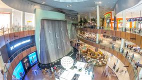 Giant fountain with flying sculpture of an diver timelapse in Dubai Mall.