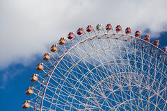 Giant funfair ferris wheel with blue sky. Background Stock Image