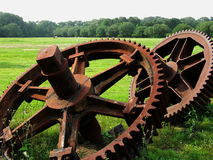 Giant Gears. Giant antique gears on the edge of a field.  I believe they were originally part of a sugar mill Stock Photography