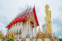 The giant golden Buddha,Buddhism,Thailand. The giant golden Buddha.Buddhism is the respect of the general.In Roi Et Province Thailand Royalty Free Stock Photo