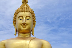 Giant golden buddha. Giant buddha face at watmuang Royalty Free Stock Photo
