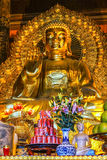 Giant Golden Buddha statue in temple with Coca-Cola offer in fro Royalty Free Stock Photo