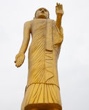 Giant golden buddha to stand. Royalty Free Stock Photo