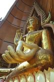 Giant golden image of Buddha Stock Photography
