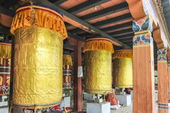 Giant golden prayer wheels at Thimphu Chorten royalty free stock photo
