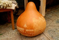 Giant gourd carving work at the shop in Chinchero town, Cusco, Peru stock photography