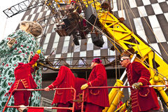 Giant Grandma puppet walks the streets of Liverpool. LIVERPOOL, UK - JULY 25, 2014: Operators of the giant Royal De Luxe street puppets in Liverpool for ' Royalty Free Stock Photo