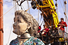 Giant Grandma puppet walks the streets of Liverpool. LIVERPOOL, UK - JULY 25, 2014: The giant Royal De Luxe street puppets in Liverpool for 'Memories of 1914 Stock Photo