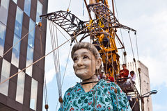 Giant Grandma puppet walks the streets of Liverpool. LIVERPOOL, UK - JULY 25, 2014: The giant Royal De Luxe street puppets in Liverpool for 'Memories of 1914 Royalty Free Stock Images