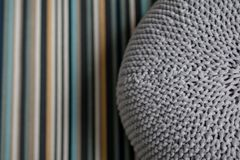 Giant gray pillow woolen knitted on striped carpet Bedroom. Interior Scandinavian Design.  royalty free stock photos