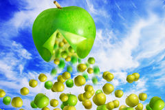 Giant green apple falling Stock Photos