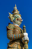Giant Guard Statue at Wat pra Kaew Bangkok Thailand. Giant Guard Statue stand insist all the gate of Wat Prakaew, the royal temple, in Bangkok Thailand Stock Photography